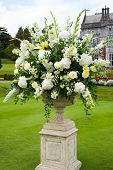 picture of opulence  - urn of opulent bouquet of flowers in manor gardens - JPG