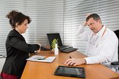 picture of prophylactic  - A Pharmaceutical Sales Representative at hospital with a  doctor - JPG