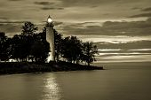 stock photo of lighthouse  - Point Aux Barques Lighthouse beacon shines over the Lake Huron coast - JPG