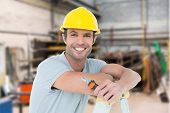 stock photo of pliers  - Technician holding pliers while leaning on ladder against workshop - JPG
