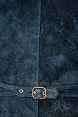 stock photo of vest  - Fragment of vest back with metal buckle - JPG