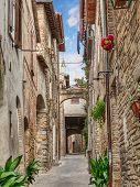 stock photo of underpass  - picturesque narrow alley with ancient building - JPG