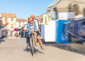 pic of street-rod  - Senior couple riding on bicycle outdoors  - JPG