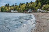 stock photo of dash  - Small waves ripple toward shore at Dash Point Washington - JPG
