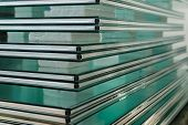 stock photo of temperance  - Sheets of Factory manufacturing tempered clear float glass panels cut to size - JPG