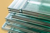 stock photo of temperance  - Sheets of Factory manufacturing tempered float glass panels cut to size - JPG