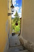 foto of descending  - Narrow descending stairs street in Cesky Krumlov - JPG