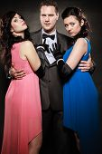 image of threesome  - Elegant people preparing for night out - JPG