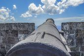 stock photo of cannon  - looking at the sky from the back of an old cannon at fort Brimstorm in St - JPG