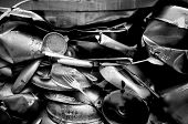 picture of junk-yard  - Junk pile up of old compressed utensils and pots closeup black and white - JPG