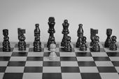 Постер, плакат: Chess Set With One Chess Pawn In Front Black And White Photo