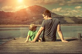 image of jetties  - Happiness father and son on the pier at sunny day under sunlight - JPG