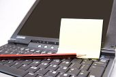 Laptop With Yellow Note