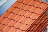 picture of roof tile  - group of stacked brand new ceramic plated roof tiles - JPG