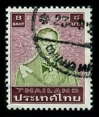 THAILAND - CIRCA 1970: A stamp printed in USA shows image portrait Bhumibol Adulyadej (Royal Institute: Phumiphon Adunyadet born 5 December 1927) is the current King of Thailand, circa 1970.