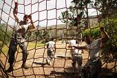 Soldiers performing training exercise on net in bootcamp poster