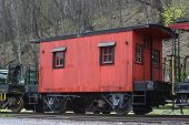 picture of caboose  - old red caboose on the railway track - JPG