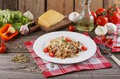 Porridge With Vegetables In Italian. Risotto With Vegetables. Still Life With A Dish And Fresh Veget poster