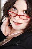 Brunette secretary with red glasses