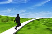 businessman walking on a path through a 3d grassy landscape under a blue sky