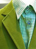 A green suit with a checked shirt