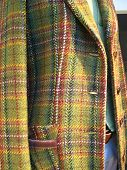 Closeup view of a portion of a lady's suit