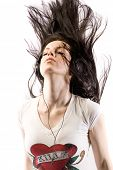 Woman headbangs to music in headphones with hair flying everywhere