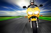 image of nomads  - Motorcycle moving very fast along motion blurred road - JPG