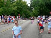 Spectators wait for Fourth of July parade
