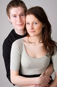 picture of young adult  - young happy teenage couple in love embracing - JPG