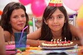 Girl celebrating her fifth birthday