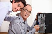 Father and son fixing a computer