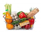 metal shopping basket with of grocery products isolated on white poster