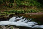 Long Exposure Of A Waterfalll At Watersmeet In Devon poster