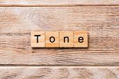 Tone Word Written On Wood Block. Tone Text On Wooden Table For Your Desing, Concept poster