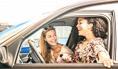 Young Female Best Friends Having Fun At Car Roadtrip Moment - Transportation Concept And Urban Ordin poster