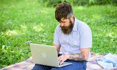 Man Bearded With Laptop Sit Meadow Nature Background. Blogger Becoming Inspired By Nature. Writer Lo poster