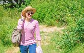 Woman In Straw Hat Walking In Nature Background. Woman Going Picnic In Nature. Girl Hiking Or Going  poster