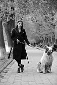 Woman Owner With Pet Outdoor. Gir Walk Dog In Spring Park. Love, Care, Trust. Pet, Companion, Friend poster