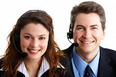 stock photo of telephone operator  - Smiling business people with headsets - JPG
