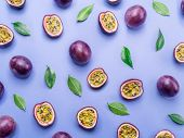 Passion fruit background. Set of passion fruits with leaves. Top view. poster