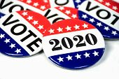 Close Up Of Political Voting Pins For 2020 Election On White poster