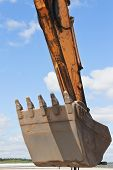 Excavator Working On Earthworks. Large Excavator Bucket. Part Of The Design Of The Machine. poster