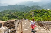 China travel at Great Wall. Tourist in Asia walking on famous Chinese tourist destination and attrac poster