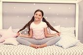 Relaxation And Meditation. Girl Child Sit On Bed In Her Bedroom. Kid Prepare To Go To Bed. Pleasant  poster