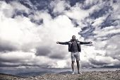 Freedom. Hipster With Serious Face And Raised Hands At Mountains. Guy Or Bearded Man At Cold Weather poster