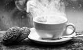 Enjoying Coffee On Rainy Day. Coffee Time On Rainy Day. Fresh Brewed Coffee In White Cup Or Mug On W poster