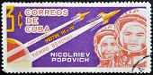 CUBA - CIRCA 1963: A stamp printed in Cuba shows Nikolayev and Popovich with rocket Vostok 3 and 4 c