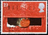 UNITED KINGDOM - CIRCA 1996: a stamp printed in Great Britain shows image of a robin sitting in a po