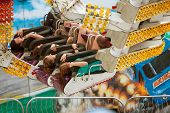 Teens Hold On During Scary Carnival Ride